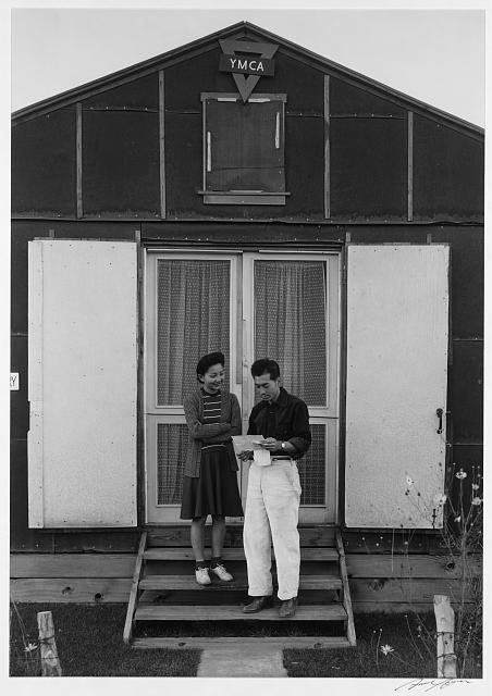 Mr. and Mrs. Hirata at Y.M.C.A. building, Manzanar Relocation Center