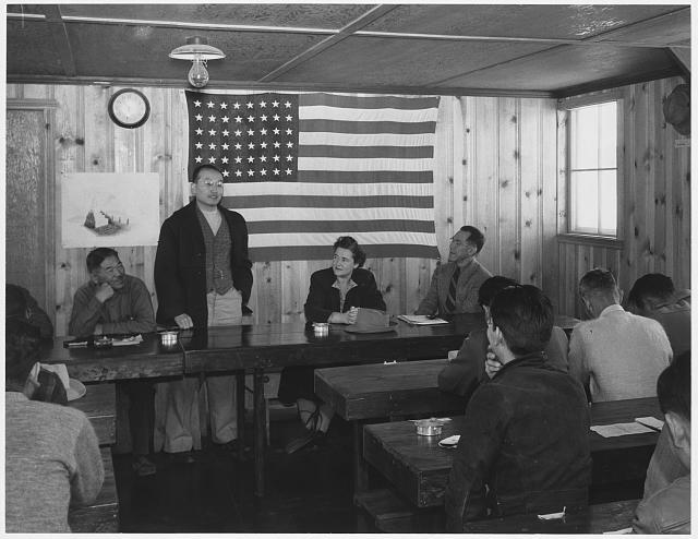 Roy Takano [i.e., Takeno] at town hall meeting, Manzanar Relocation Center, California