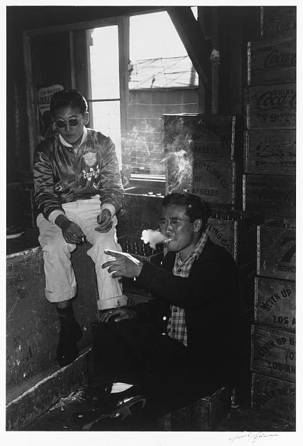 Two young men in co-op goods store, Satoru Nasunoko & Bill Idama, Manzanar Relocation Center