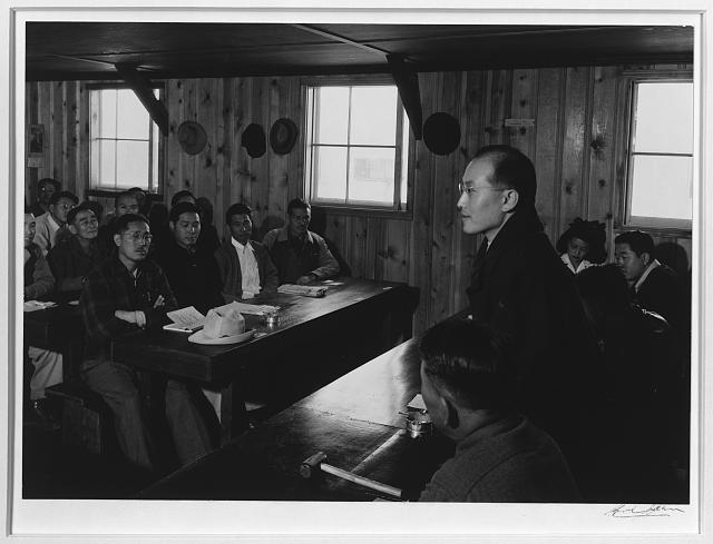 Roy Takano [i.e., Takeno], town hall meeting from side, Manzanar Relocation Center