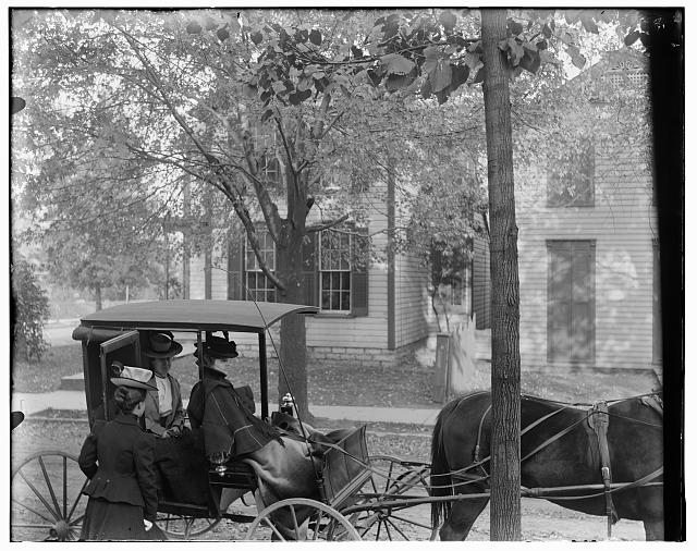[Katharine Wright, Harriet Silliman, and Agnes Osborne in horse-drawn carriage across from Wright home, 7 Hawthorn Street, Dayton, Ohio]