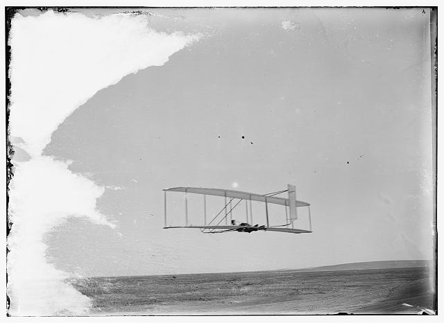 [Wilbur gliding in level flight, single rear rudder clearly visible; Kitty Hawk, North Carolina]