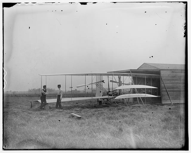 [Wilbur and Orville Wright with their second powered machine; Huffman Prairie, Dayton, Ohio]