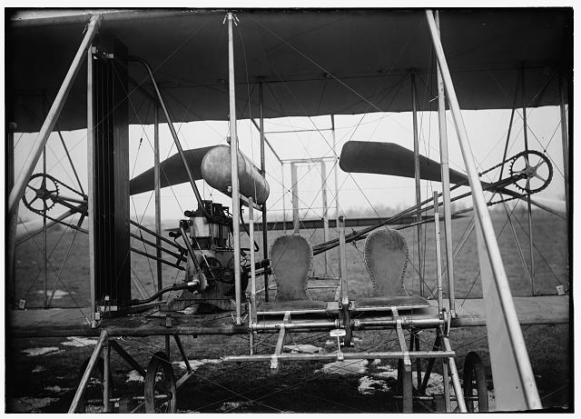 [Close-up view of airplane, including the pilot and passenger seats]