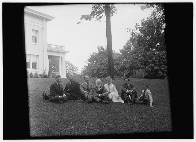 [Group picture of Orville Wright, Bishop Milton Wright, Katharine Wright, Earl N. Findley, nephew Horace Wright, John R. McMahon, and Pliny Williamson, all seated on the lawn of Orville's home, Hawthorn Hill; Dayton, Ohio]