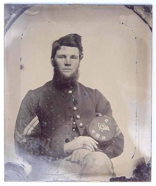 [Unidentified soldier in Union corporal's uniform holding Company B, 15th New Hampshire Volunteers kepi]