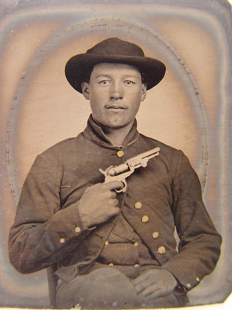 [Unidentified soldier in Union uniform with slouch hat holding revolver to chest]
