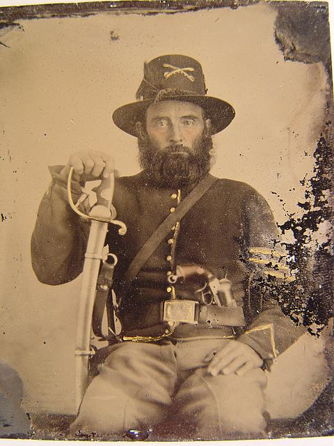 [Unidentified soldier in Union cavalry uniform and Hardee hat with European import saber and French LeFaucheux pinfire revolver]