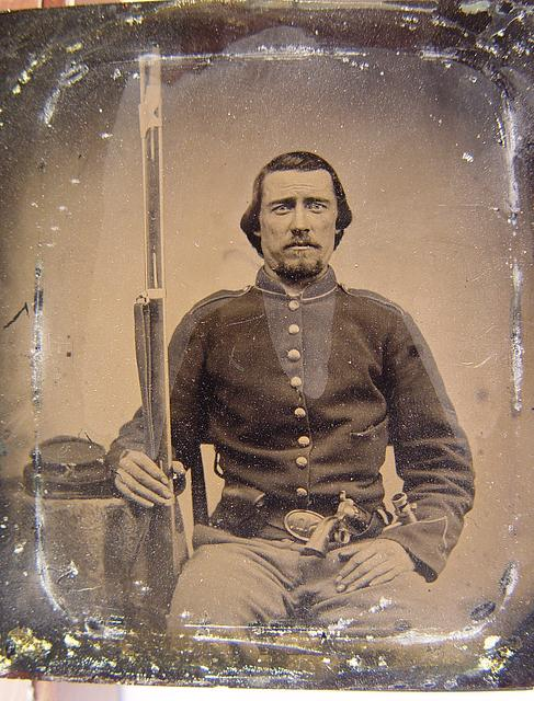 [Unidentified soldier in Union uniform with musket, revolver, cap box, and bayonet]