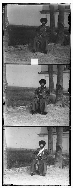 [Isfandiyar, Khan of the Russian protectorate of Khorezm(Khiva), full-length portrait in uniform, seated on chair, outdoors]
