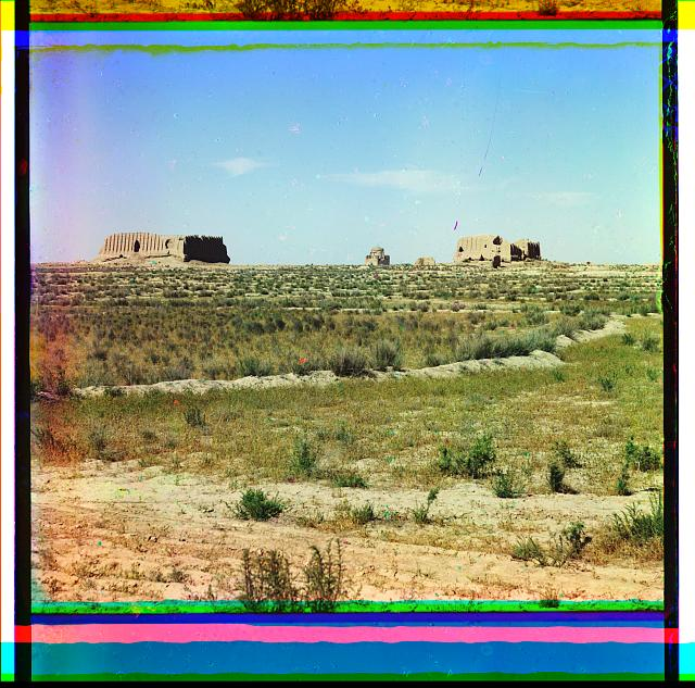 [Adobe buildings in desert plains]