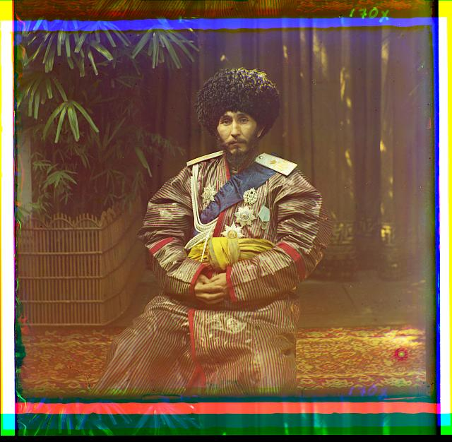 [Isfandiyar, Khan of the Russian protectorate of Khorezm(Khiva), in uniform, seated on chair, outdoors]