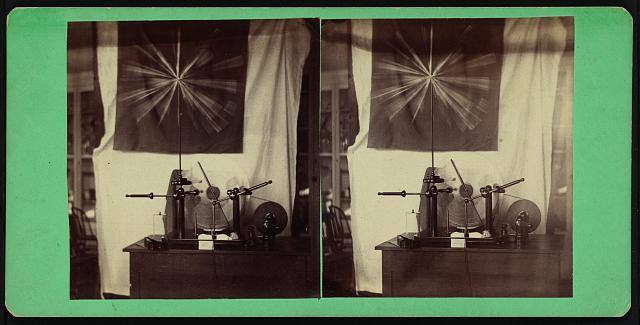 [Holtz  machine emitting sparks]