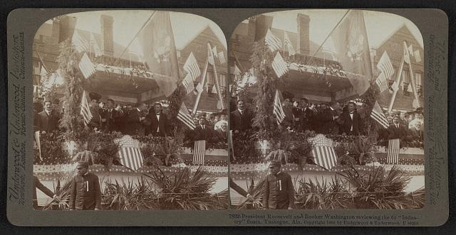 "President Roosevelt and Booker Washington reviewing the 61 ""industry"" floats, Tuskegee, Ala."