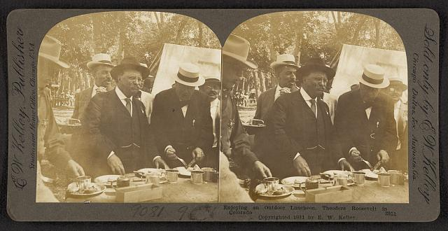 Enjoying an outdoor luncheon, Theodore Roosevelt in Colorado