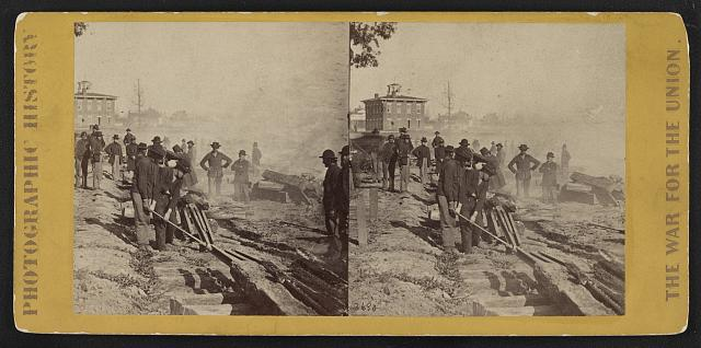 Gen. Sherman's men destroying the railroad before the evacuation of Atlanta, Ga.