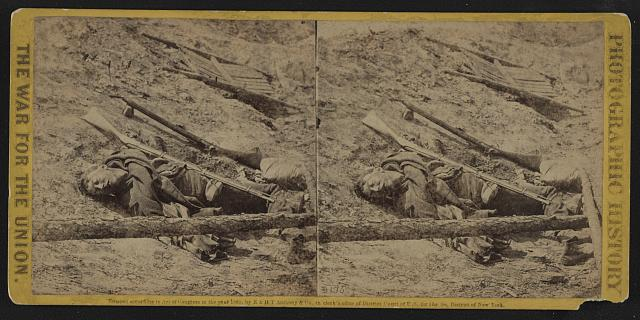 A dead rebel soldier, as he lay in the trenches of Fort Mahone, called by the soldiers &quot;Fort Damnation&quot;