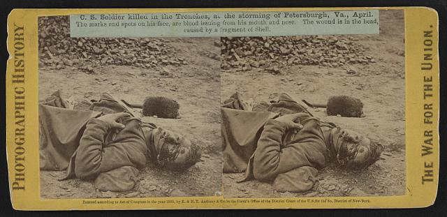 C.S. soldier killed in the trenches at the storming of Petersburgh (i.e. Petersburg), Va., April. The marks and spots on his face are blood issuing from his mouth and nose. The wound is in the head, caused by a fragment of shell