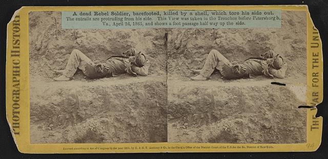 A dead rebel soldier, barefooted, killed by a shell, which tore his side out. The entrails are portruding from his side