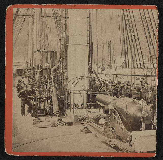 [Sailors and a cannon on deck of a gunboat]