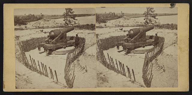 Eight inch Brooke rifled gun, weighing 21,987 lbs., in unfinished battery wood-hurdle revertment (i.e. revetment), anchored by grape vines