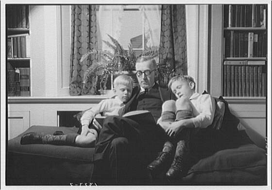 Wyckoff children. Two boys and father reading on couch II
