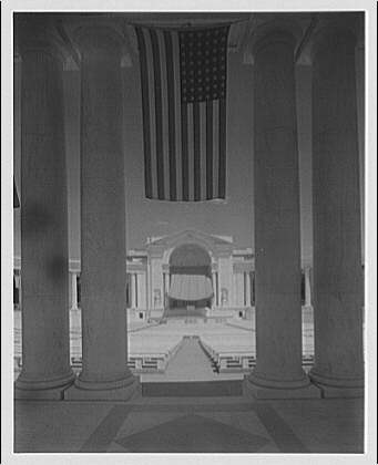 Arlington National Cemetery. Rostrum of Arlington National Cemetery Amphitheater with canopy through column with flags I