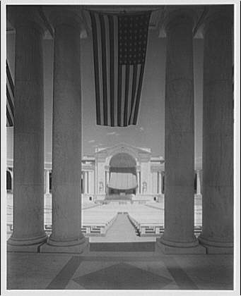 Arlington National Cemetery. Rostrum of Arlington National Cemetery Amphitheater with canopy through column with flags II