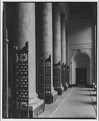 U.S. Supreme Court interiors. Columns and grille gates along hall in U.S. Supreme Court
