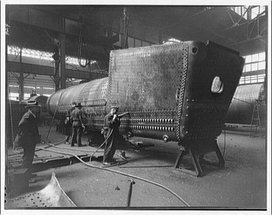 Construction of a railroad engine. Erection of boiler