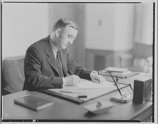 Dr. Joseph Quincy Adams, first director of the Folger Library. Dr. Adams at desk VI