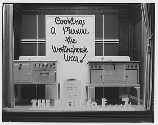 "Electric Institute of Washington. Window display of electric ranges with sign, ""Cooking's a pleasure the Westinghouse way"""