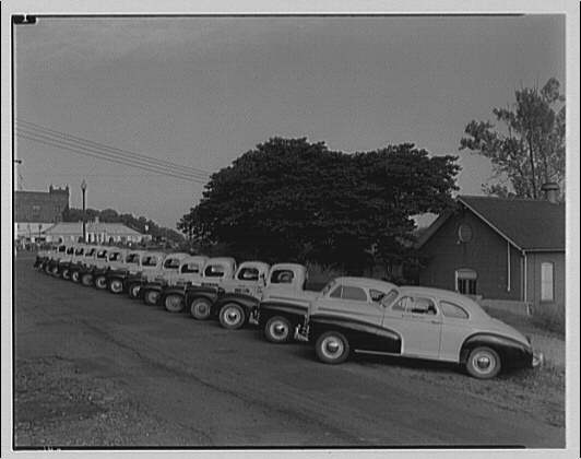 Griffith Consumers Co. Row of Griffith Consumers Co. service trucks I