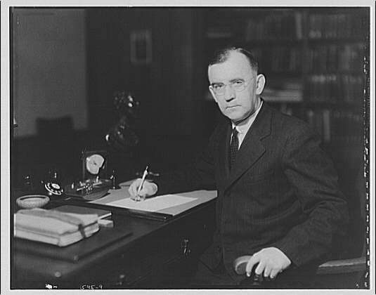 Dr. Joseph Quincy Adams, first director of the Folger Library. Dr. Adams at desk VIII