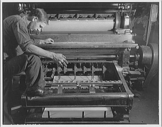 Printing shops in Washington for Stanford Paper Co. Man working at printing press