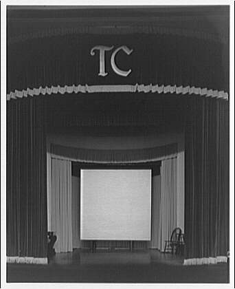 Trinity College. Stage curtains with Trinity College emblem