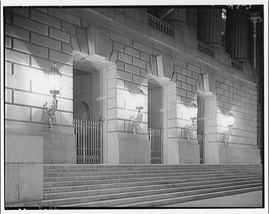 U.S. Customs Service, Departmental Auditorium, and the Interstate Commerce Commission Building. Entrance to Departmental Auditorium at night
