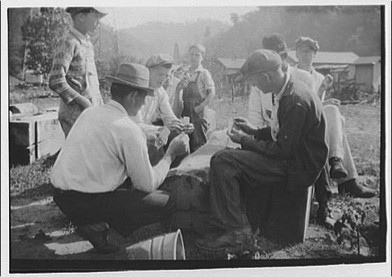 Striking miners drawing rations, West Virginia. Group of miners playing cards