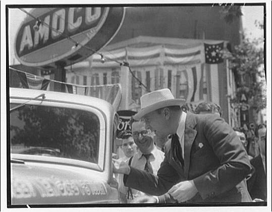 Ford V-8 economy run. Senator Robert R. Reynolds of North Carolina looking in the car on its arrival at the show