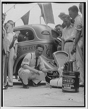 Ford V-8 economy run. Chester S. Ricker, technical supervisor of AAA, preparing to weigh and measure gas and oil