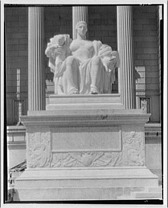 National Archives. Statue at left of Constitution Ave. entrance of National Archives, close-up