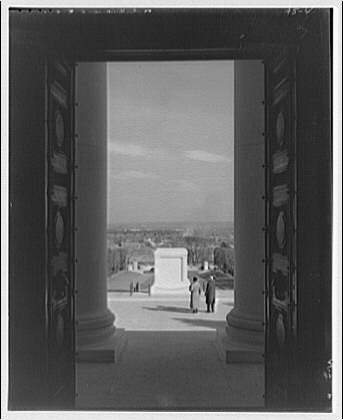 Arlington National Cemetery. Tomb of the Unknown Soldier with aged couple through door