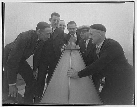 Washington Monument. Men examining aluminum cap of Washington Monument