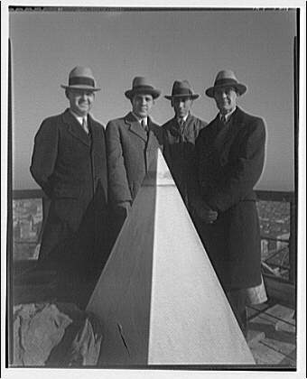 Washington Monument. Group of men standing by cap stone of Washington Monument I