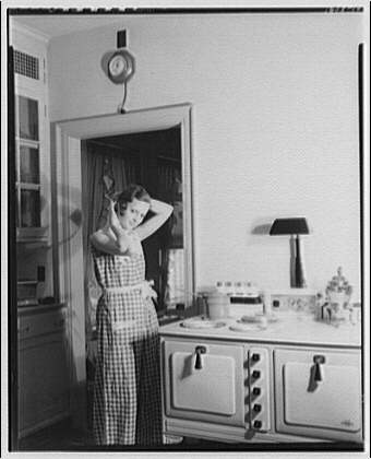 Potomac Electric Power Co. electric appliances. Model preparing breakfast