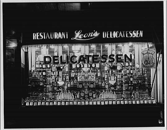 Leon's Delicatessen. Window display of whiskey at Leon's Delicatessen II