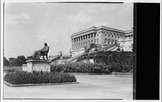 U.S. Capitol exteriors. Statue of John Marshall and Senate wing of U.S. Capitol