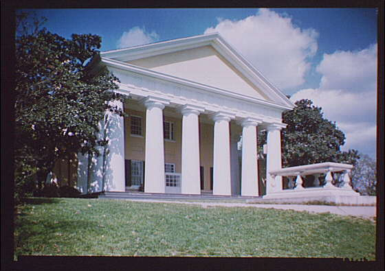 Arlington National Cemetery. Custis-Lee Mansion exterior with woman on porch