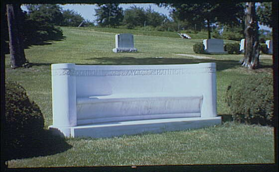 Statues and sculpture. Marble bench in cemetery possibly in High Point, North Carolina