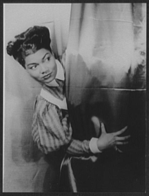 [Portrait of Pearl Bailey, takes a call after singing A Woman's Prerogative in St. Louis Woman]